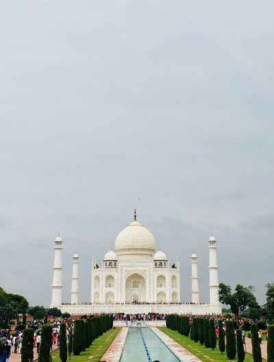 Taj mahal in city against sky