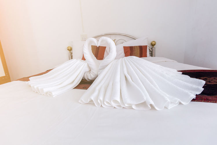 Bed Bedroom Celebration Cozy Domestic Room Event Fashion Furniture Indoors  Life Events Love Luxury No People Pillow Sheet Still Life Textile Wedding Wedding Dress White Color