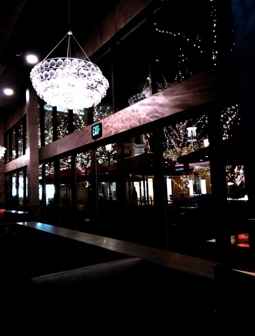 hanging, illuminated, lighting equipment, indoors, night, built structure, no people, architecture, tree, city