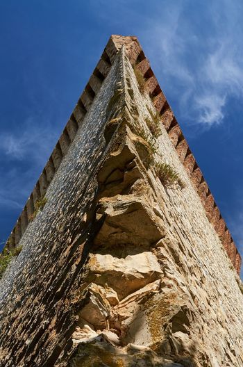 Fortress tower, Castiglione del Lago Italy Umbria Castiglione Del Lago Blue Sky Looking Up Tower Bricks Lines Fort Fortress Weathered Textured  Textures And Surfaces Historic Historical Building Built Structure Ancient No People Low Angle View Outdoors Stone