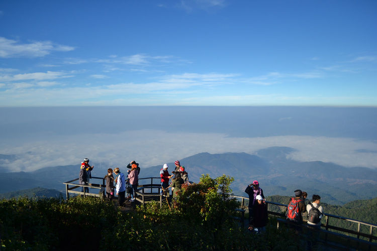 People at observation point against sky