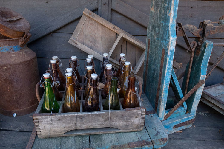High angle view of bottles in crate