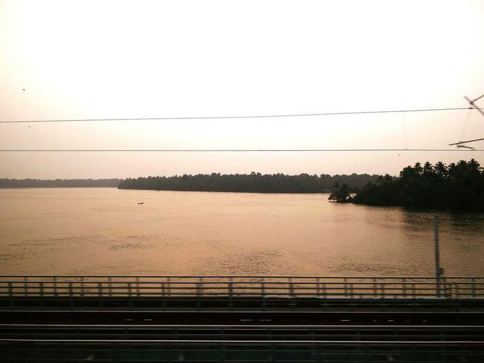 Today's Sun set for me over Ashtamudi lake reaching Kollam in Kerala, south India. #motionpic #OnTheMove #train Journey #journey #railway #bridge #Lake #ashtamudi #kerala #Dusk #evening Water Sunset Lake Sky