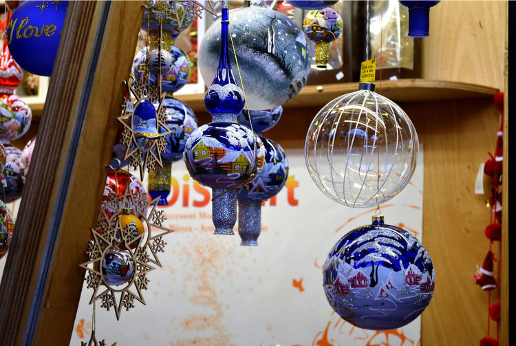 Close-up of decorations hanging in store for sale in market