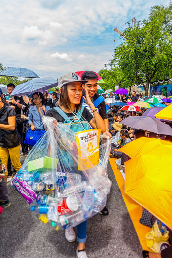 Volunteers collect rubbish as Thais gather in Bangkok to sing the Thai Royal Anthem in honour of HM King Bhumibol Adulyadej. Adult Bangkok City Customer  Day King Bhumipol Adulyadet Outdoors People Person Real People That's Me Two People Vertical Volunteer Volunteering Volunteers