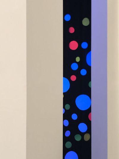 Close-up of illuminated lighting equipment on wall