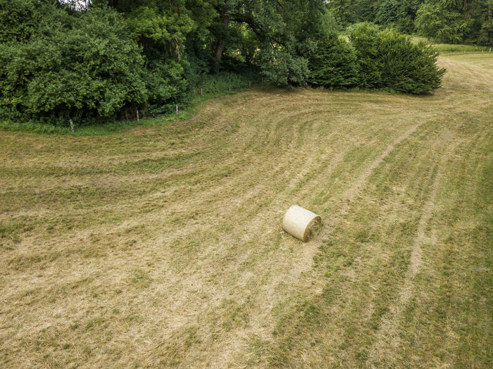 High Angle View Of Hay Bale On Agricultural Field