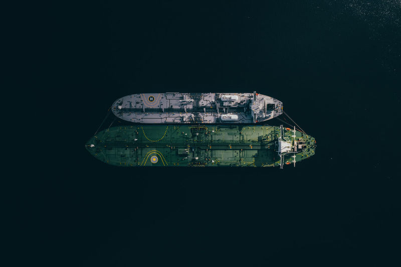 High angle view of boat in sea against black background