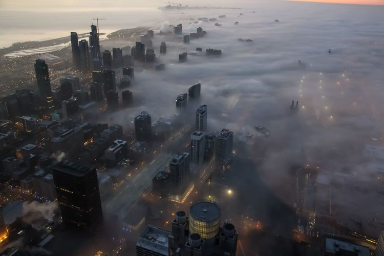 A foggy sunrise in Chicago Building Exterior Architecture City Cityscape Built Structure High Angle View Sky Skyscraper Aerial View Cloud - Sky Travel Destinations Modern Financial District  Chicago Fog Foggy Foggy Morning Dawn Sunrise Clouds And Sky Cityscape Urban Urban Skyline Landscape Downtown