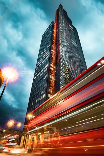 Architecture Building Exterior Sky Skyscraper City Cloud - Sky Speed Illuminated Built Structure Modern Blurred Motion Outdoors Transportation Low Angle View Mode Of Transport Motion No People Night London