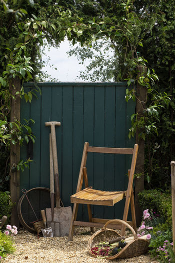 Wooden table and chairs in yard
