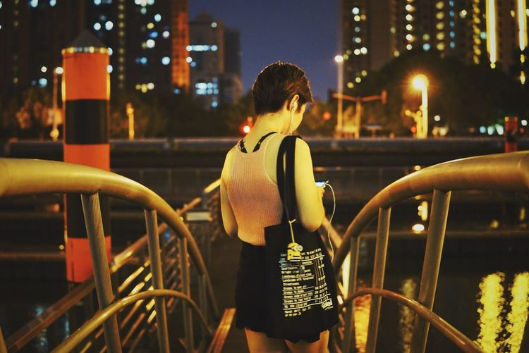 Night City Building Exterior Built Structure City Life Architecture Outdoors Illuminated One Person Rear View Focus On Foreground Lifestyles Young Adult Real People Women Young Women Tree Adult People