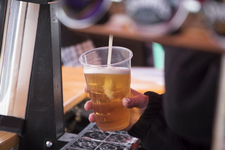Pouring beer into plastic glass Alcohol Beer Beer Glass Beer Pour Close-up Drink Drinking Glass Food And Drink Happy Hour Holding Human Hand Lager Plastic Glass Plastic Glasses Refreshment
