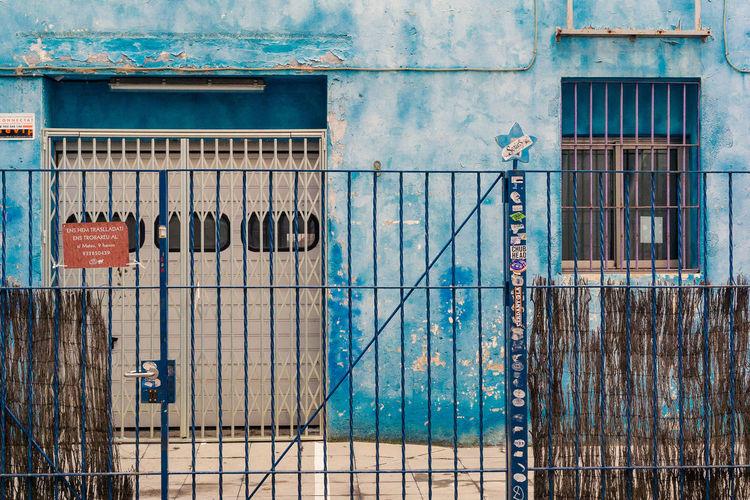 Fence Against Blue Building