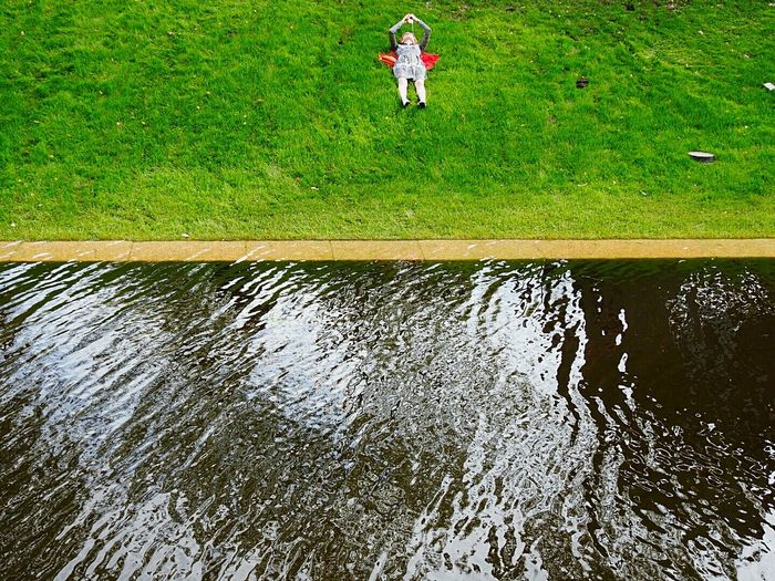 Relaxation Green Color One Woman Only Grass Walking Water Colour Of Life Colors Of Sankt-Peterburg Color Of Life! Canal EyeEM Photos Urban Geometry New Holland Island Saint Petersburg Russia