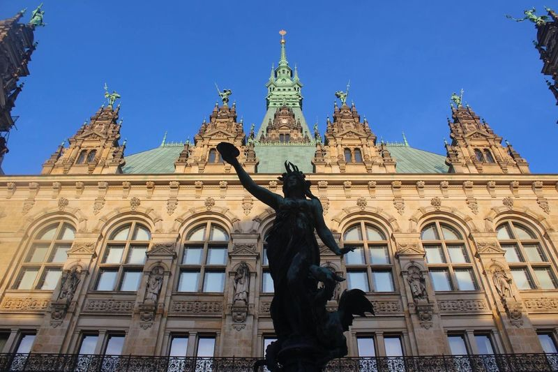 Hof Rathaus Hamburg Townhall Townhall Hamburg Rathaushamburg Rathaus Hamburg Statue Sculpture Architecture Human Representation Building Exterior Male Likeness Art And Craft Built Structure Low Angle View Travel Destinations Day Outdoors History No People Sky Clear Sky City EyeEmNewHere