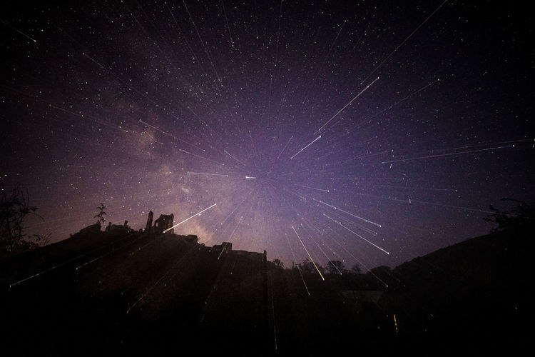 Low angle view of silhouette stars against sky at night