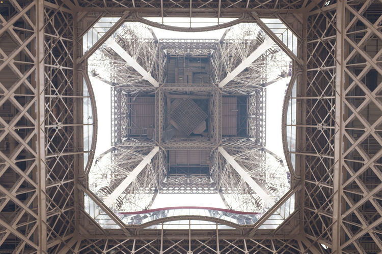 Structural view of the Eiffel Tower in Paris, France photographed from directly below. Eiffel Tower View From Below Abstract Architecture Looking Up Geometric Shape Structure Building France French Square Paris Monument Underneath