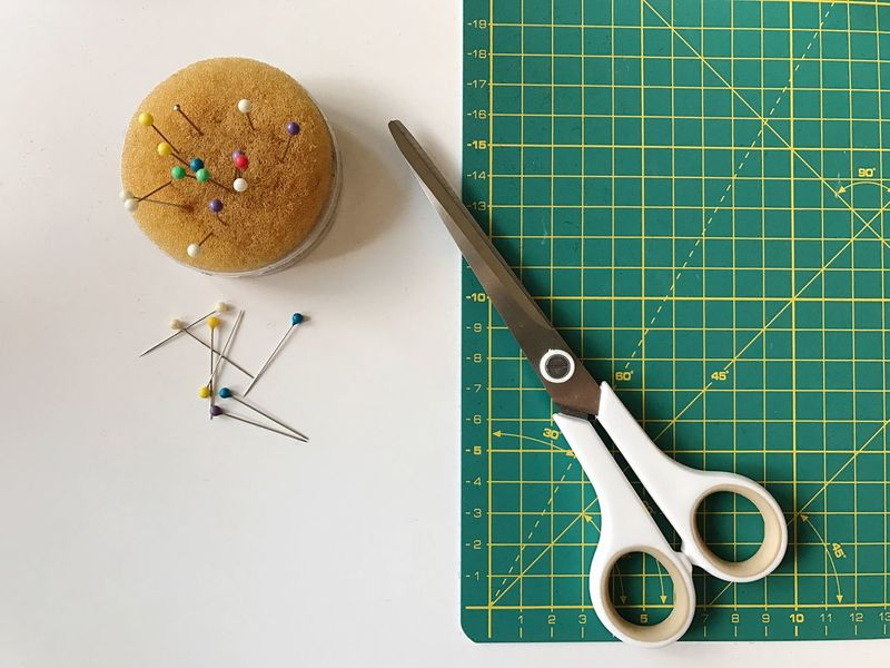Sewing Cutting Board Cutting Scissors Cut Pin Pincushion Cushion Handicraft Table Indoors  Working Tailoring Fashion Textile Design Designing White White Table Close-up No People Day Atelier Lines Structure