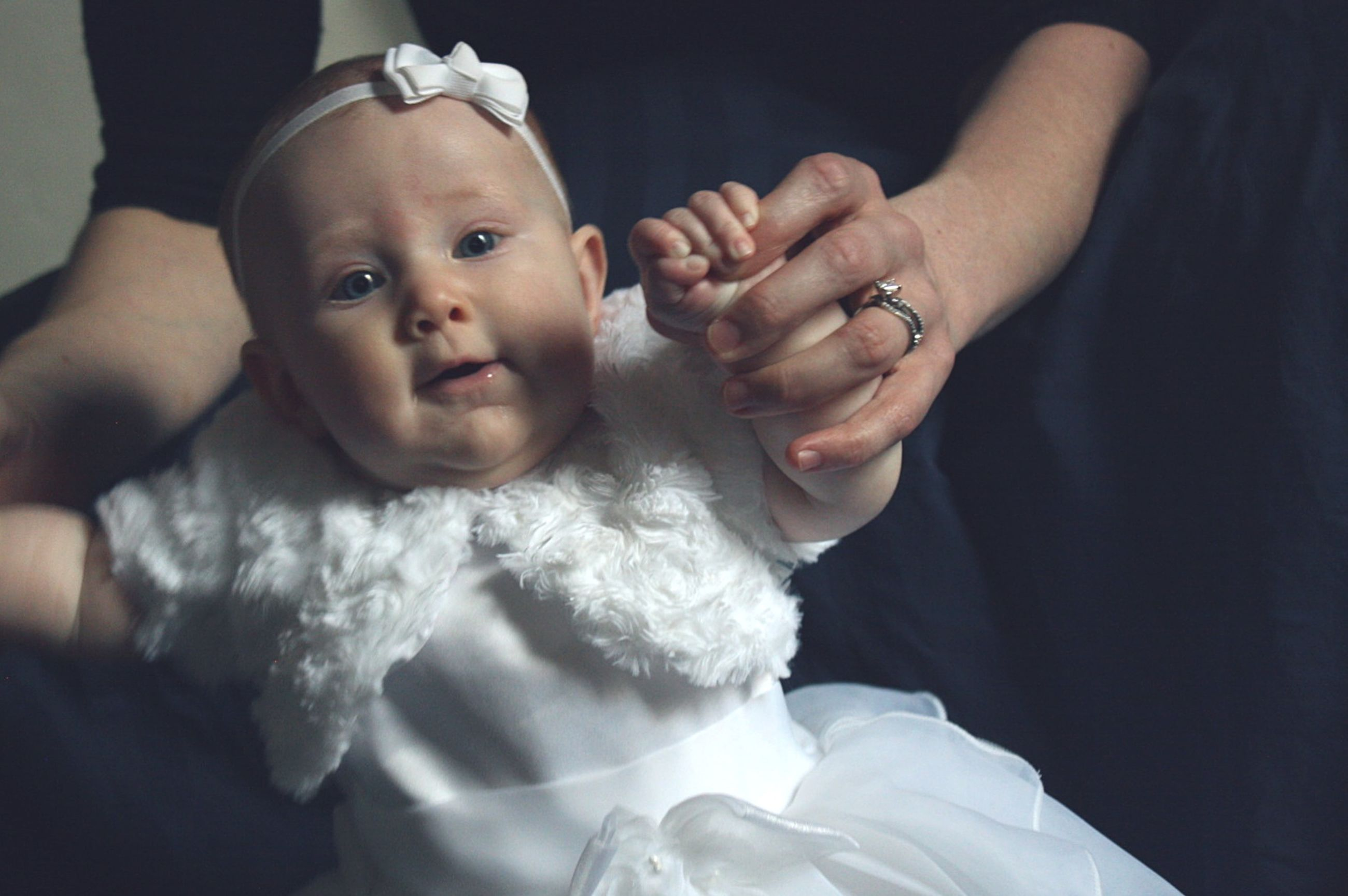 baby, childhood, real people, two people, togetherness, innocence, love, cute, babyhood, indoors, lifestyles, holding, human hand, bonding, close-up, day, people