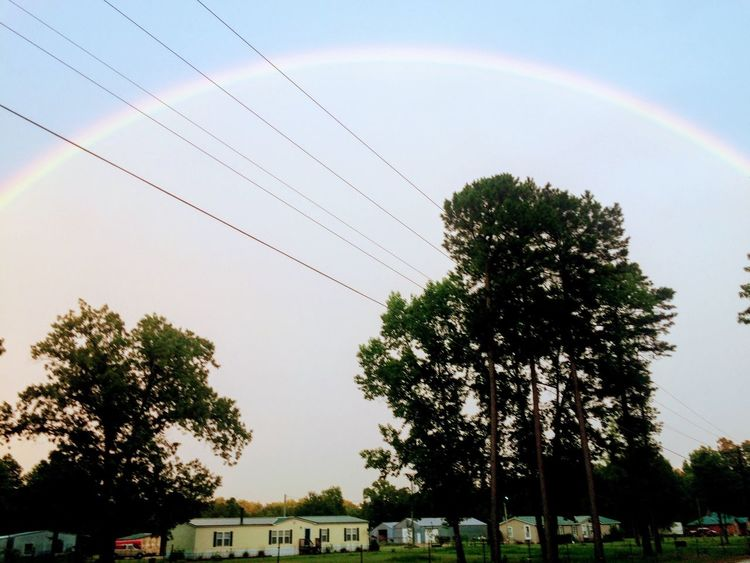 EyeEm Selects house under full view of rainbow and sky Tree Rainbow Nature Sky No People Beauty In Nature Outdoors Day