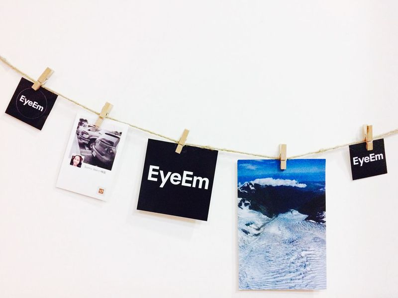 EyeEm Eyem Stickers Hanging On The Wall