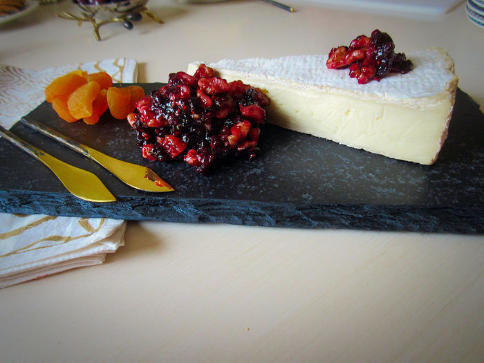 High angle view of brie with cranberry chutney on granite