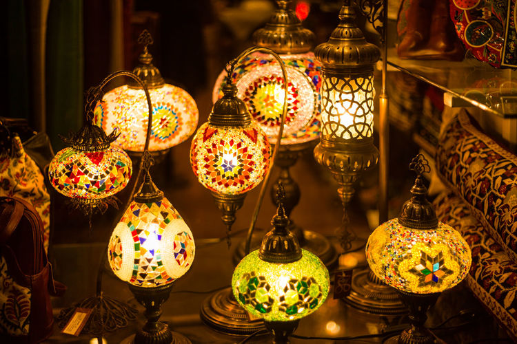 Low angle view of illuminated lanterns in store