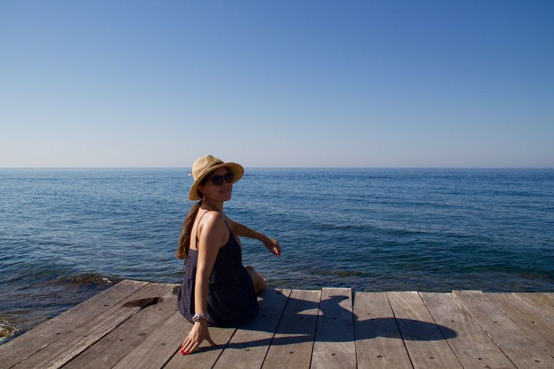 Cyprus Paphos Sitting Sitting Outside Vacations Beach Beautiful Woman Beauty In Nature Clear Sky Full Length Horizon Over Water Jetty Lifestyles Nature One Person Outdoors Pier Relaxation Scenics Sea Summer Sun Hat Sunlight Water Young Adult