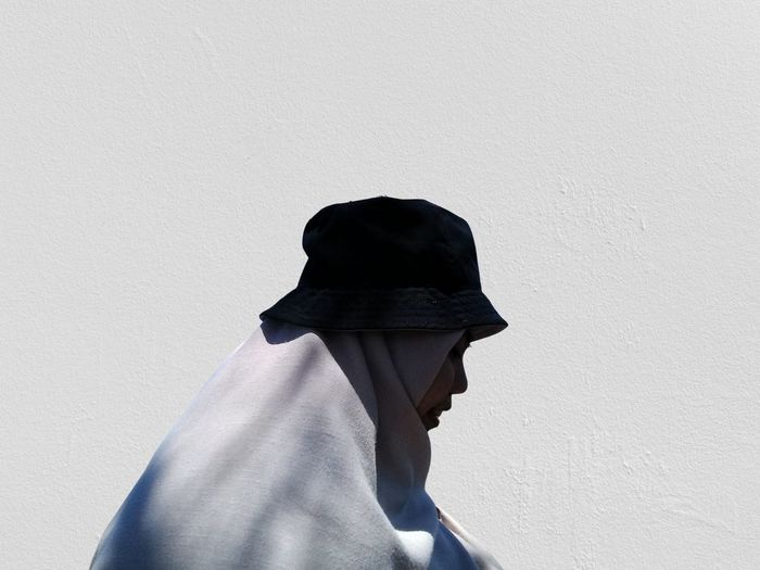 Side view of woman against white wall. - feeling like a shadow -