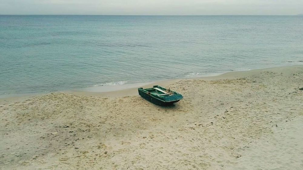 Beach Sea Sand Abandoned Horizon Over Water Nature Outdoors Water Day Beauty In Nature No People Sky Hanging Out Nature Street Photography Taking Photos Sabledoré Winter Tunisia Beauty In Nature Streetphotography Backgrounds My Favorite Place Bizerte Sable Sandy Beach