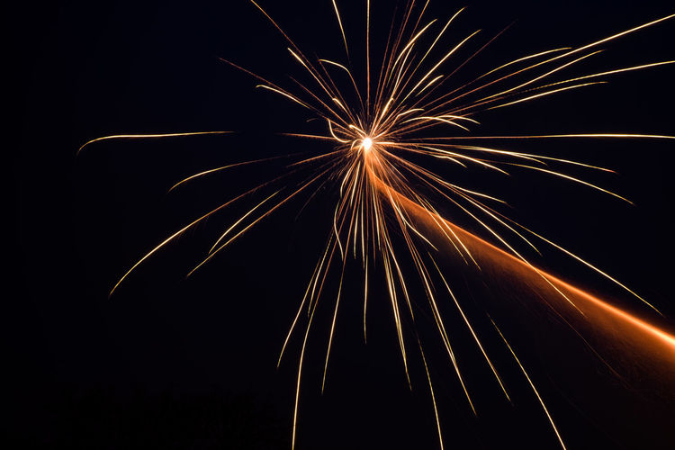 Low angle view of firework exploding against clear sky