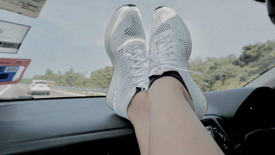 """Out Of The Box NIKE Flyknit Racer """"Goddess"""" on a roadtrip. Car Transportation Vehicle Interior Mode Of Transport Land Vehicle Car Interior Real People One Person Dashboard Day Leisure Activity Men Women Low Section Lifestyles Sitting Sky Indoors  Human Body Part Close-up Nikeflyknitracer Flyknitracer Nike Sneakers"""