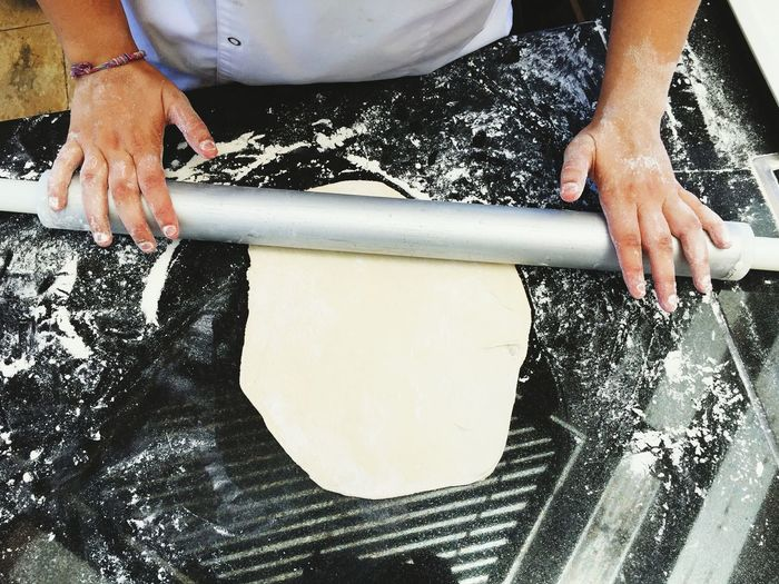 Hands Using Rolling Pin