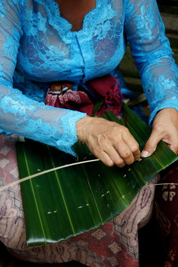 Someone prepares the equipment for the ngaben ceremony in ubud bali indonesia.