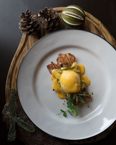 High angle view of eggs benedict in plate on table