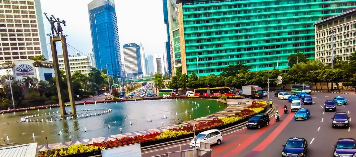 Jakarta city indonesia Architecture Built Structure City Building Exterior Transportation Mode Of Transportation Motor Vehicle Car Building Land Vehicle Road City Life Traffic Street Nature Water Office Building Exterior Plant Modern Tree