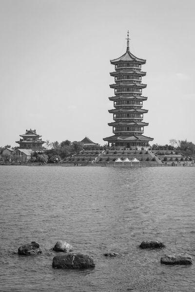 Pagoda Pagoda Architecture Clear Sky Day No People Outdoors Religion Sky Travel Destinations Water Waterfront