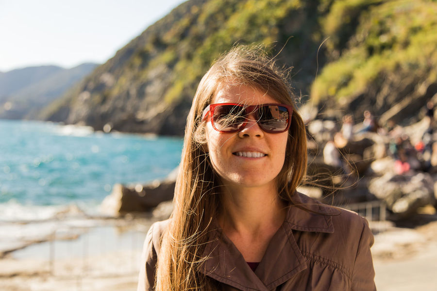 Adult Adults Only Beach Blond Hair Cinque Terre Cinque Terre Cityscape Cinque Terre Landscape Cinque Terre Liguria Cinque Terre Manarola Day Headshot Italy Lifestyles Liguria,Italy Mid Adult One Person One Woman Only Only Women Outdoors Portrait Standing Sunglasses Sunlight Travel Vacations