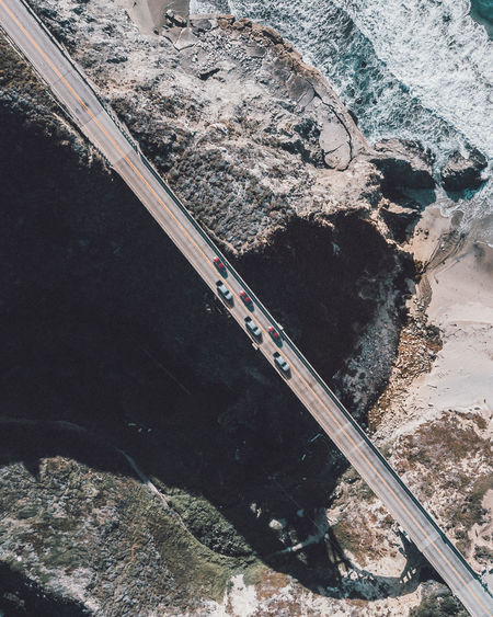 Go on Bixby High Angle View Transportation Day Nature No People Water Outdoors Track Rail Transportation Railroad Track Sign Architecture Rock Road Built Structure Rock - Object Metal Sunlight Travel Sea Bixby Bridge California