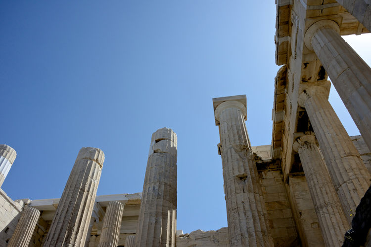low angle view of columns in the Acropolis in Athens Architecture Sky Built Structure Clear Sky History Low Angle View The Past Ancient Architectural Column Ancient Civilization Building Exterior Nature Old Ruin Copy Space No People Day Travel Destinations Travel Blue Tourism Archaeology Outdoors Ruined Pillars Archeological Site Greek Ruins Athens, Greece Acropolis, Athens Background Past Ancient Architecture