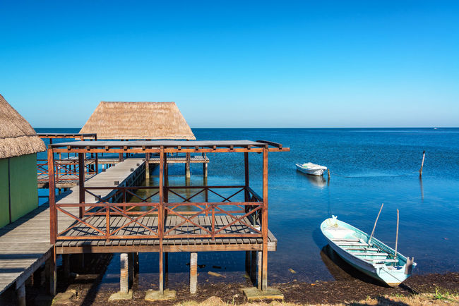View of a pier and boats in the town of Champoton, Mexico Architecture Beach Blue Campeche Caribbean Champotón Day Dock Horizon Landscape Mexican Mexico Nature Nautical Vessel Outdoors Peninsula Scenics Sea Sky Transportation View Water Waterfront Yucatan Mexico Yúcatan