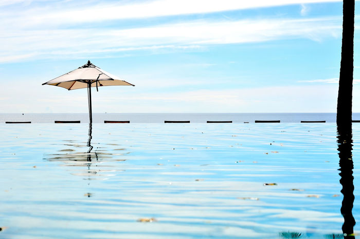 Beach Front Beauty In Nature Cloud - Sky Day Hua Hin Beach Fron Nature No People Outdoors Pool Time Reflection Resort Sand Sea Sea And Sky Sky Sun Swimming Pool Thailand Tranquil Scene Tranquility Umbrella Water