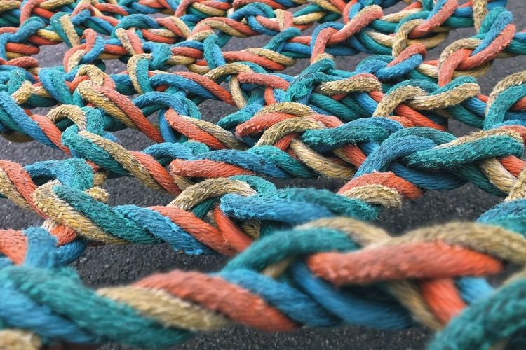 Interlacing multi-colored rope on the playground.