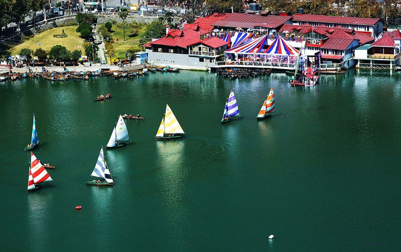 High angle view of sailboat sailing in river
