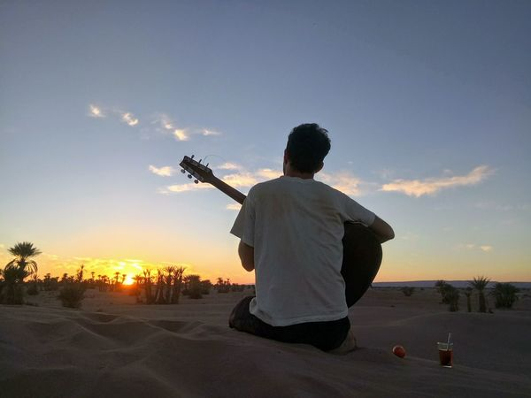 Adult Desert Desrt Scenes Lifestyles Man With Guitar Marrakech Marruecos Music Musical Instrument Nature One Person Outdoors Sahara Desert Sahara Sand Sky Sunset