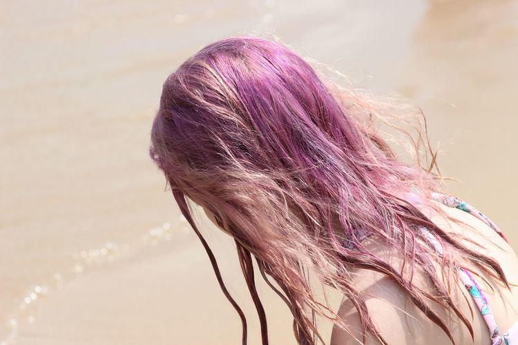 Close-up of woman with dyed hair at beach