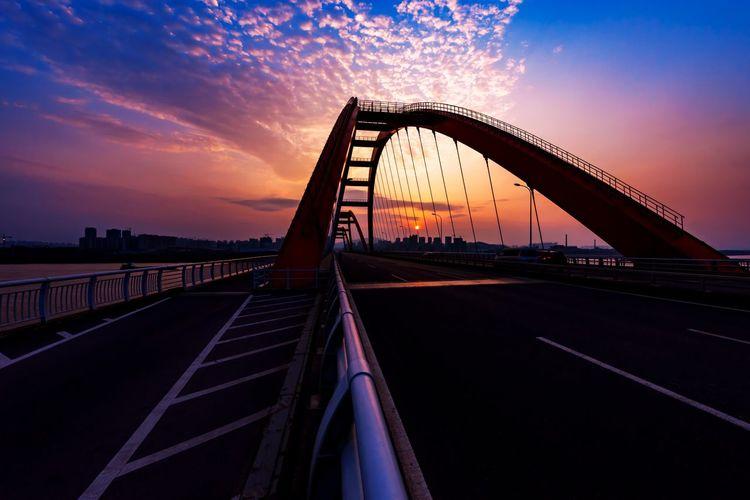Empty Road On Bridge At Sunset