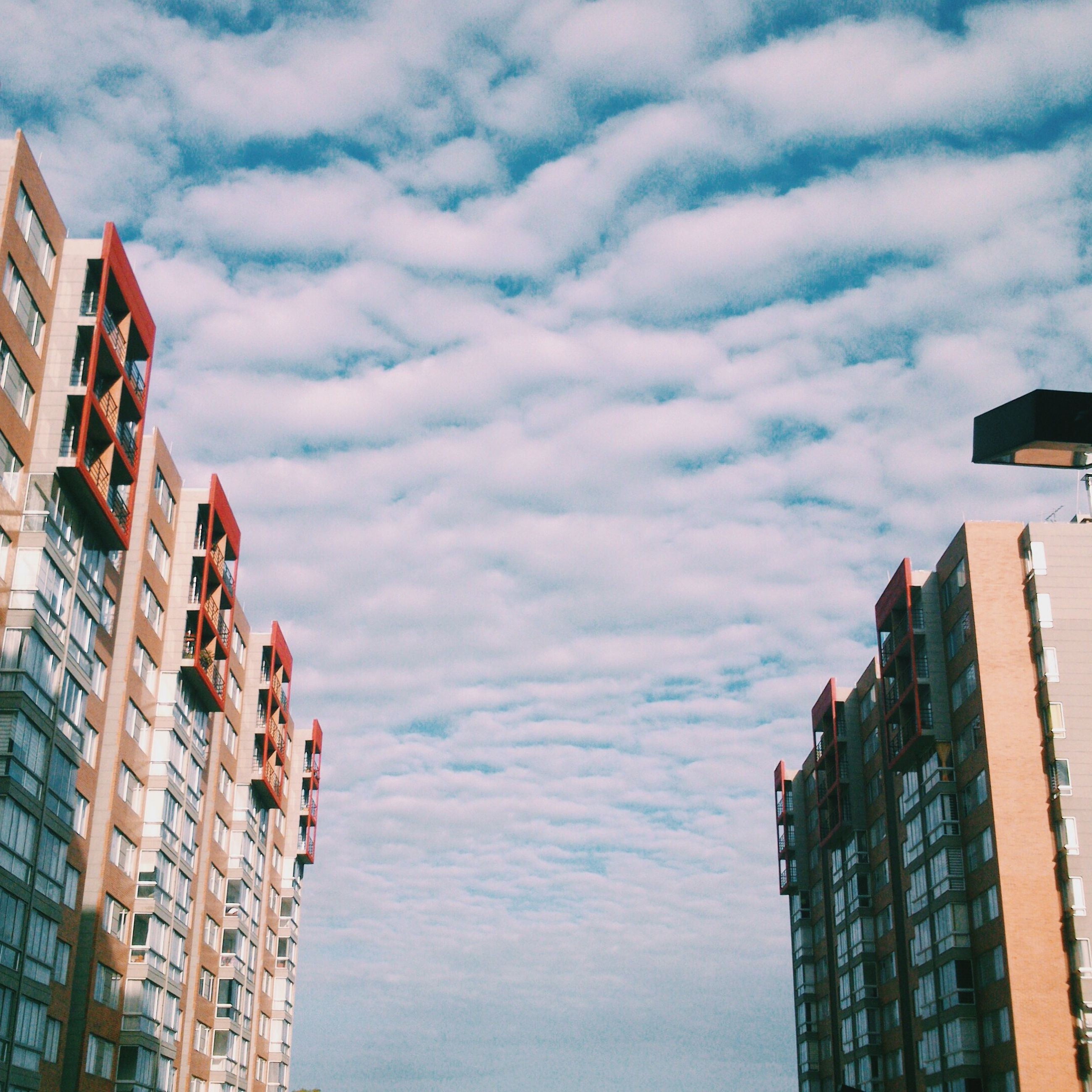 architecture, building exterior, built structure, low angle view, sky, city, cloud - sky, building, residential building, residential structure, cloudy, cloud, tall - high, window, outdoors, day, modern, no people, tower, office building