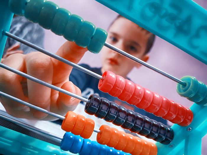 Abacus Boy Close-up First Grade Math Mathematics School Studying idle JR doing math. Edit: idleBG.com Market Reviewers' Top Picks
